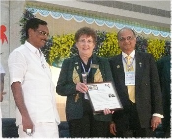 Rotary District Governor Marlene Brown presented a plaque by Rotary District Governor L. Narayanaswamy and R. I. rep, at their District Conference in India