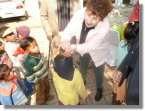 Rotary District Governor Marlene Brown taking part in the NIDS polio drops north of Delhi, India